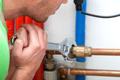 Hard working plumber — Stock Photo