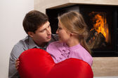 Couple in love by fireplace — Stock Photo