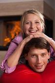 Fun by fireplace — Stock Photo