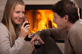 Red wine by fireplace — Stock Photo