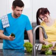 Wife washing broccoli in kitchen — Stock Photo #42149505