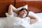 Man sleeping in bed — Stock Photo