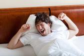 Yawning man after awakening — Stock Photo