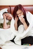 Ailing couple in bedroom — Stock Photo