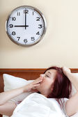 Waking up and yawning woman — Stock Photo