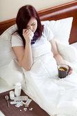 Ailing woman drinking tea — Stock Photo