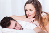 Sleeping man and pretty woman — Stock Photo