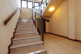 Modern stone stairs with wooden banister — ストック写真