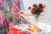 Painting a bunch of flowers — Stock Photo