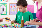 A boy playing creative colourful games — Stock Photo