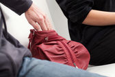 Slipping into a bag — Stock Photo