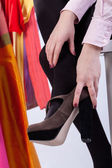Woman putting shoes on — Stock Photo
