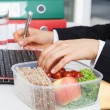 Eating and working — Stock Photo