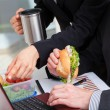 Eating at the desk — Stock Photo