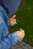 Sad teenager with cigarette — Stock Photo