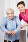 Nurse with elderly woman — Stock Photo