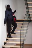 Criminal on staircase — Stock Photo