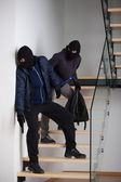 Two criminals on stairs — Stock Photo