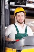Happy forklift driver — Stock Photo