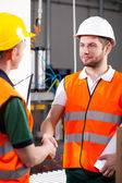 Workers in factory — Stock Photo