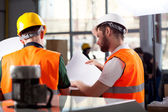 Factory workers planning — Stock Photo