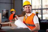 Smiling factory worker — Stock Photo