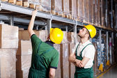 Workers in warehouse — Stock Photo