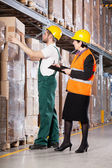 Superior and worker in warehouse — Stock Photo