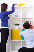 Daughter and mother during dusting — Stock Photo