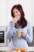 Sleepy woman drinking coffee — Stock Photo