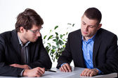 Businesmen consulting an angreements — Stock Photo