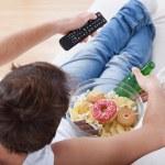 Couch potato watching match — Stock Photo #44309803