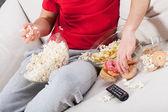 Couch potato watching tv — Stock Photo
