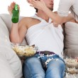 Woman slapping couch potato — Stock Photo #44311443