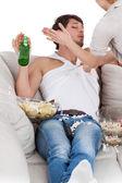 Woman slapping couch potato — Stock Photo
