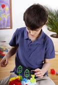 Precise boy with toys — Stock Photo