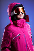 Winter sportswoman in pink — Stock Photo