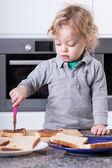 Child making sandwich — Stock Photo