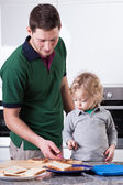 Father and son preparing breakfast — Stock Photo