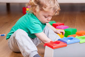 Toddler playing on the floor — Stock Photo