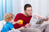 Bored child looking at father — Stock Photo