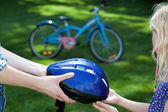 Helmet and the little girl — Stock Photo
