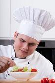 Chef decorating salad — Stock Photo