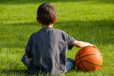 Boy sitting on the grass — Foto Stock