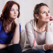 Female friends watching movie — Stock Photo #44559361