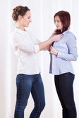 Friends trying on shirt — Stock Photo