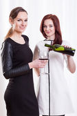 Elegant ladies with wine — Foto Stock