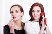 Women making up — Stock Photo