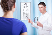 Oculist examining patient  — Stock Photo