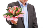 Man giving flowers — Stock Photo